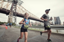 My daughter Mia running her first 10K at age 7